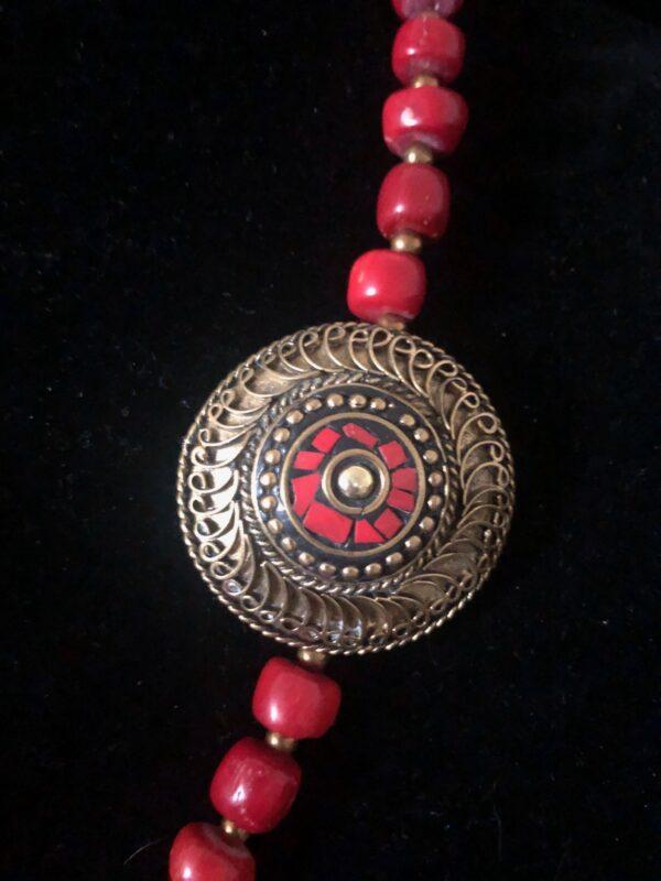 bronze and red round bead
